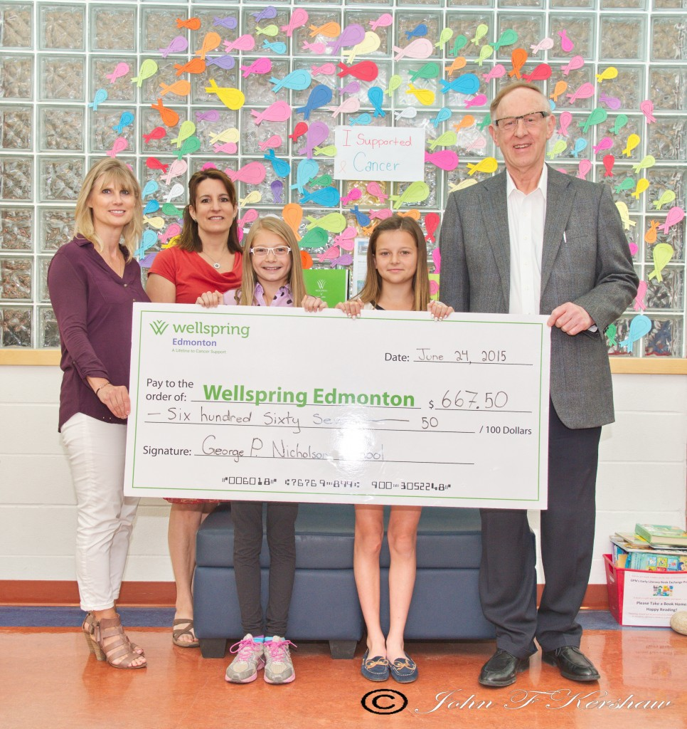 From left to right: George P. Nicholson Principal Roma Paul, Vice-principal Nicole Schmidt, Grade 6 student Morgan, Grade 6 student Emelyn, Wellspring Board Chair Dr. Glenn Hundleby - presenting a cheque of $667.50 for Wellspring Edmonton. Students at George P. Nicholson School raised the money.