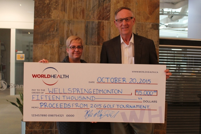 Dr. Glenn Hundleby accepts a cheque for $15,000 from World Health, represented by Candice Sperling.